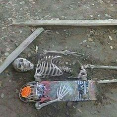 skeleton with skateboard skater skating dead buried death