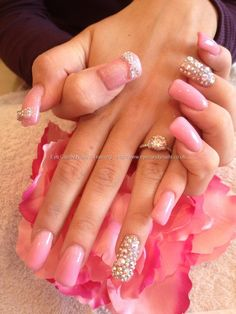 Acrylic nails with pink gel and 3d bows with Swarovski crystals
