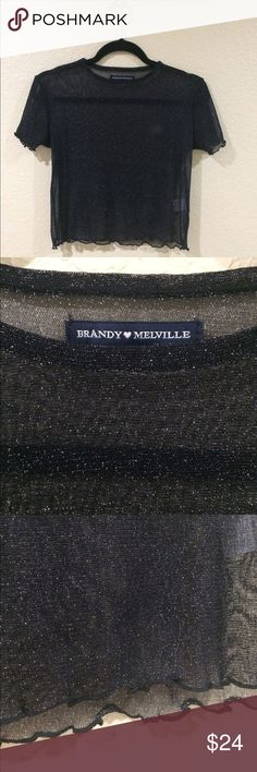 Brandy Melville porter glitter top Super sheer mesh glitter tee in black with ruffled trimmings. Super cute for a night out. Pair it with a nice bralette or crop top underneath. Brand new without tag. Never been washed or worn either. ** NO TRADES** Brandy Melville Tops Blouses