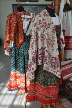 Traditional costumes of peasant girls from Kostroma Province, Russia, on display in the local museum. Embroidered long blouses, sarafans (a kind of sleeveless dresses) and beautiful shawls. Early 20th century. #Russian #folk #national #costume