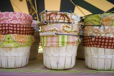 I could figure out good uses for fabric lined bushel baskets.  I also loved the palette of these fabrics.