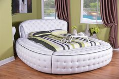Sleep in comfort and style with this Round Diamond Bed set. The contemporary design of this double/queen-size bed has an modern bling finish and a faux leather construction. This stunning platform bed features a padded, button-styled with rhinestone headboard atop the padded, button-styled platform base. The rich, faux leather gives your bedroom a refined, high-class look. With a rounded headboard that will catch anyone's eye, this Diamond Bed set has s modern look that offers timeless…