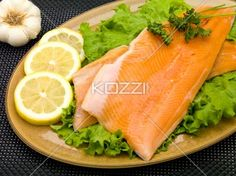 Fillet with Lemons and Garlic - Raw rainbow trout fillets on a plate