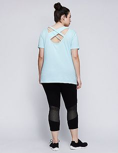 Strappy? Check. Edgy? Check. Totally you? Check. Game on in this ready-to-move LIVI Active tee. Scoop neck. lanebryant.com
