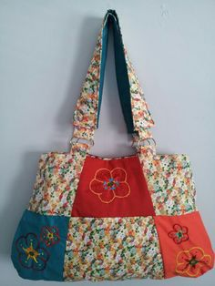 Shoulder bag with flowers embroidery done on it! This is one of a kind bag!