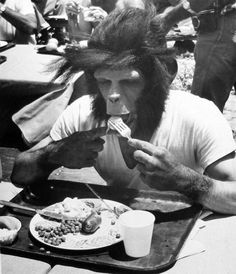Roddy mcdowall enjoys lunch on the set of planet of the apes.