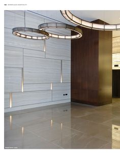 Stunning combination of flooring, wall finish and lighting.