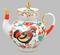 Our Red Rooster teapot is one of our most colorful teapots and sure to be a treasured collectible.  Made of fine Russian porcelain, this teapot holds 20 ounces and features a rooster in unique detail. Exquisite gold accents with pops of bright red are a stunning accent to any decor.   10 ounce capacity.