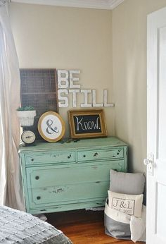 Vignette with weathered turquoise dresser, frames with ampersand and chalkboard, DIY faux metal letters