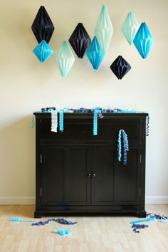 diy paper lanterns. In the right colors hung with an led light inside.