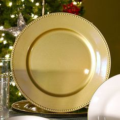 The perfect finishing touch for holiday table settings! Plastic chargers have a decorative beaded rim and make a stylish presentation under dinner plates. They also look great displayed on a wall or u
