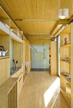 Interior of shipping container summer house; Gardenista