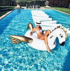 I may or may not need this...! -- A giant Pegasus pool floatie that'll make your summer ~the stuff of myth.~