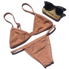 thebikinienthusiast:  The Bikini Enthusiast  I'm going NUDE tomorrow in this amazing ribbed bikini courtesy of Static Swimwear Werkin' it with a little help from Balibody and their magical tan-enhancing elixir (because it's all about the tan)