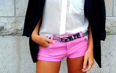 Neon pink shorts with a studded belt and blazer for sophisticated glam