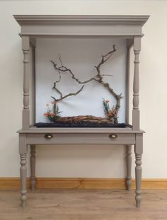 Neat aviary DIY!  All you need is a writing desk, table legs, a little wood, molding and some wire.