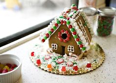 How to Make a Gingerbread House recipe - I really like making gingerbread houses with my children, but I feel that I must tell you a few things first to prepare you. 1. It will make a giant mess, over the course of a few days. 2. Your children will eat more candy in one sitting than they probably will eat in a month. 3. It will be so much fun that it will be totally worth having dried royal icing all over your house and hyper children. #holiday