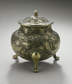 China  Lidded Tripod Jar with Flowers, Birds, and Clouds, Early or middle Tang dynasty, about 618-800  Metalwork; silver, Hammered silver with chased and partially gilded decoration