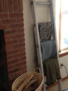 Use an antique ladder to hold extra blankets to cozy up with. @Lori Shillingburg I WANT ONE! :-)