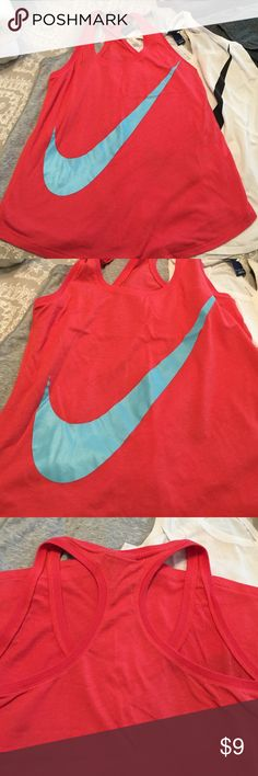 Nike Razor back Tank Size Small Color Bight Pink with light blue Check excellent used condition Nike Tops Tank Tops