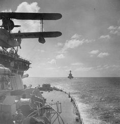 French Battleship Lorraine seen from HMS Resolution possibly in July 1943. A Supermarine Walrus is seen on X turret.