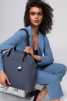The O.G. & O.M.G in Heather Slate Blue by Lo & Sons - your favorite travel carryalls, now available in a casual yet business-ready neutral. Effortlessly marrying form with function, the O.G. and O.M.G. have a zippered compartment for shoes, a sleeve to at