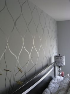 Flat paint, then glossy enamel in the same color create a subtle wallpaper-like look.