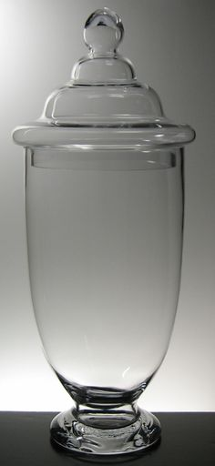"Large 23"" Clear Glass Apothecary Jars $22    Apothecary Jars at discount prices.    Weighted Glass Apothecary Urn with Glass Lid 23"" tall $22    Regular price $56.99 each"