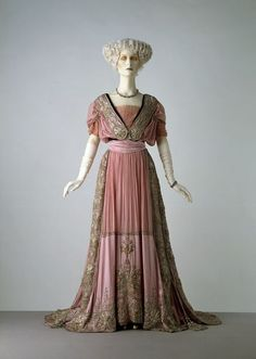 Evening dress designed by Jays Ltd. made in 1908. satin with silk panels embroidered with silvier-gilt strip, coil, thread, spangles, pearls and diamantes, and trimmed with velvet, with boned bodice; net is modern replacement