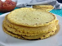 Authentic Mexican Corn Tortillas Recipe | fromcatstocooking.com   turned out nice. house was humid so dough was sticky. need to refrigerate balls before pressing