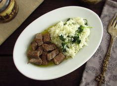 Veal cubes with coriander rice | Food From Portugal. Delicious veal cubes seasoned with pepper and salt, that are going to the oven with garlics, bay leaf, margarine and olive oil, served with coriander rice.  http://www.foodfromportugal.com/recipe/veal-cubes-coriander-rice/