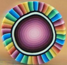 Rainbow Stripes Edged Polymer Clay Medium Circle Cane - Cosmic Colors'. $5,00, via Etsy.