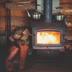 Cabin wood stove creates a cozy atmosphere. Winter Cabin, Cozy Cabin, Cabin Homes, Log Homes, Cabins And Cottages, Tiny Cabins, Log Cabins, Mountain Man, Mountain Cabins
