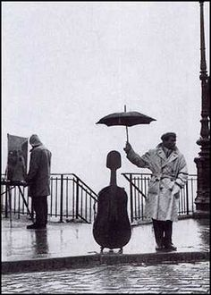 one of my favorite photos by one of my favorite photographers  Musician in the Rain, Robert Doisneau
