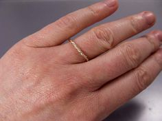 This is one of my favorite mixed metals stacking rings. I hand form this ring from two individual strands of wire, forming a seamless twist. You may choose a mix of sterling silver with yellow gold or rose gold and I will custom make this ring to order in your size. I tumble it for strength and hand polish it to a high shine. I can also give it a matte finish or oxidize the silver at your request. Each dainty ring is just a touch over 1.5mm thick. The 1st three photos show the 18k Yellow…
