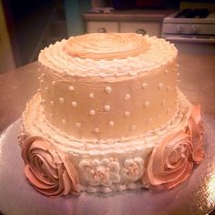 Mini 3-tier chocolate cake with buttercream flowers and pearls
