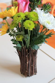 tin can vase with twigs // don't like arrangement, but love the idea for the vase
