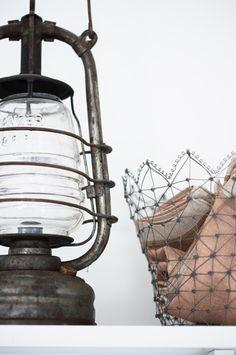 vintage lantern and wire basket  ~ Magnus Anesund