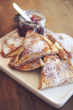 Monte Cristo Wrap Sandwich  --  Thin sliced Deli ham and turkey, Swiss cheese, and mustard wrapped up in soft flat bread then dipped in a slightly sweetened egg wash and pan grilled on both sides as you would French Toast. To serve, sprinkle with powdered sugar or dip in raspberry jam.