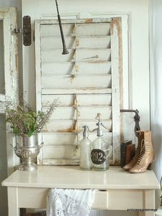 an old door..an old shutter..add silver, glass and leather..simply divine....
