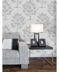 This beautiful wallpaper comes in a pale stone colour with a dark silver metallic trees design that features pretty bird silhouettes. The design is printed on to luxury heavyweight paper to ensure durability and a quality finish.