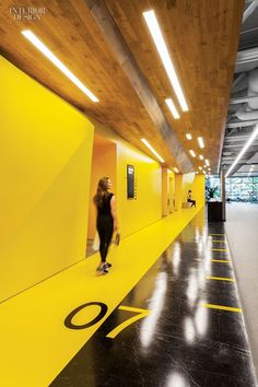 Gensler San Jose's Fitness Center for Symantec | Numbers are stenciled on the main corridor's polished concrete floor. #design #interiordesign #interiordesignmagazine #fitness @gensleron