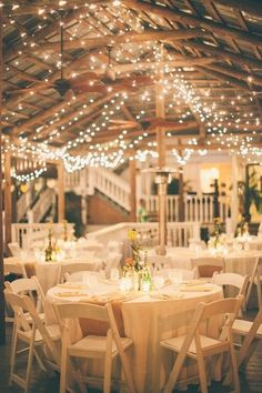country wedding reception ideas- Burlap for the table runners and Xmas lights all over the pavilion