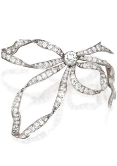 Gold, Platinum and Diamond Bow Brooch, Circa 1900. The stylized bow set in the center with an old European-cut diamond weighing approximately 1.15 carats, further set with old European-cut and rose-cut diamonds weighing approximately 9.00 carats, with removable brooch fitting.