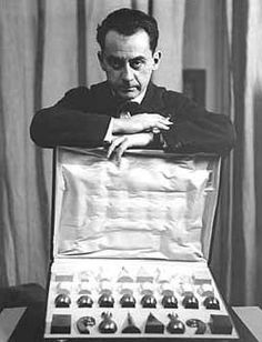 Man Ray with his Chess set design. Chess was a popular preoccupation with Surrealist artists and with Man Ray's frequent collaborator Marcel Duchamp. A 1945 exhibition devoted to chess included some of Man Ray's works.