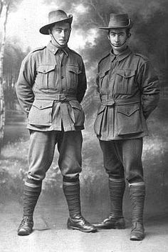 Hedley Colwell Jnr and John Colwell; both wearing gumboots