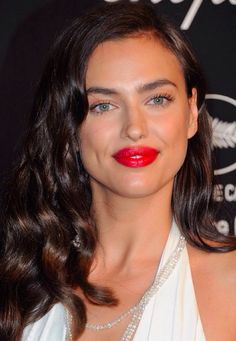 Irina Shayak… The Sports Illustrated beauty completed the movie star look with her hair style in curls and lashings of red lipstick.
