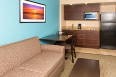 Enjoy a full kitchen and living area in our oceanfront suites