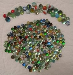 marbles - used to play this in the passage way next to my house with my friends, there was a manhole cover which had recesses in it