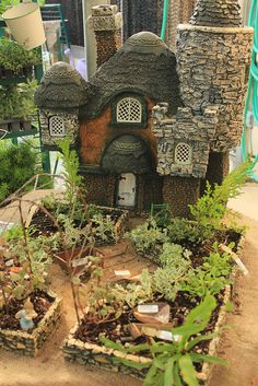 I know this is a fairy house garden, but I love the layout for our garden. :)